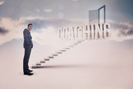 The word coaching and smiling businessman standing against white steps leading to open door photo