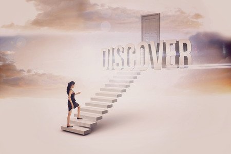 discover: The word discover and businesswoman stepping up white steps leading to closed door