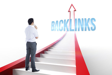backlinks: The word backlinks and businessman holding glasses against red arrow with steps graphic