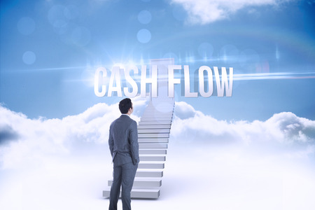 The word cash flow and businessman standing against shut door at top of stairs in the sky photo