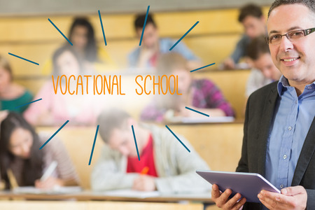 vocational: The word vocational school against lecturer standing in front of his class in lecture hall