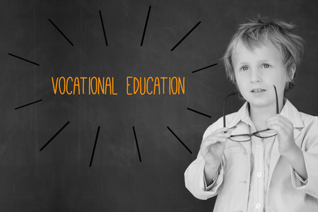 vocational: The word vocational education against schoolboy and blackboard