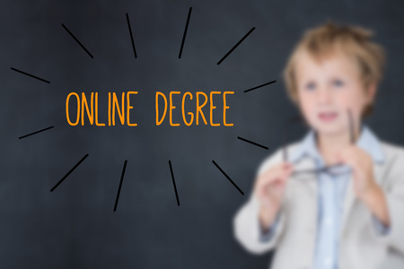 online degree: The word online degree against schoolboy and blackboard Stock Photo