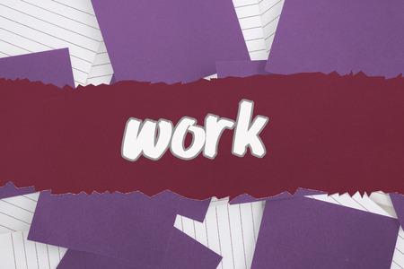 untidy text: The word work against purple paper strewn over notepad