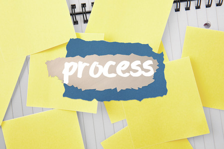 untidy text: The word process against sticky notes strewn over notepad Stock Photo