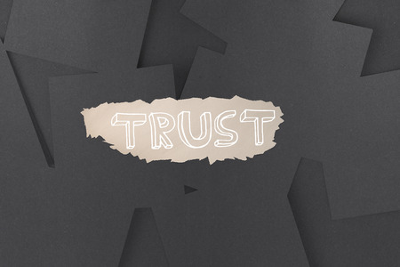 untidy text: The word trust against digitally generated grey paper strewn Stock Photo
