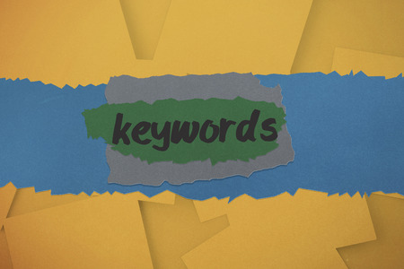 The word keywords against digitally generated orange paper strewn Stock Photo - 28969653