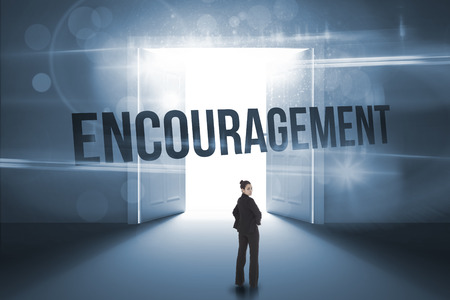 The word encouragement and serious businesswoman against doors opening revealing light