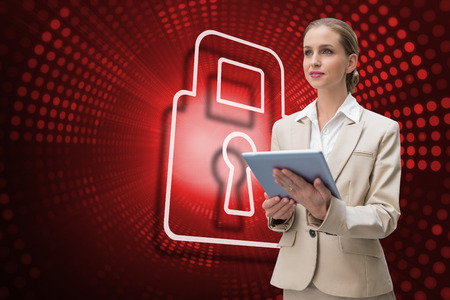 Composite image of lock and businesswoman using tablet against red pixel spiral photo