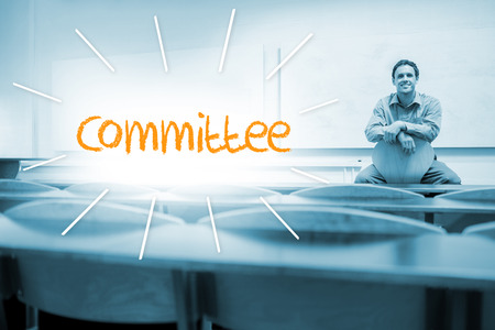 committee: The word committee against lecturer sitting in lecture hall