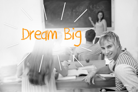 The word dream big against students in a classroom photo