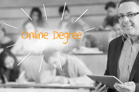 online degree: The word online degree against lecturer standing in front of his class in lecture hall