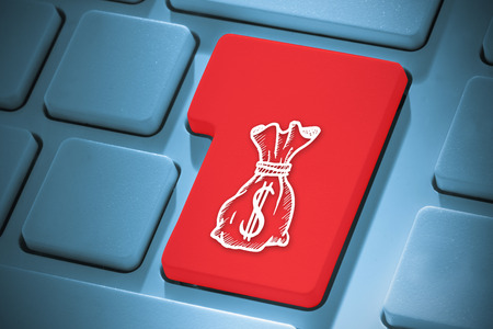 Money bag against red enter key on keyboard photo