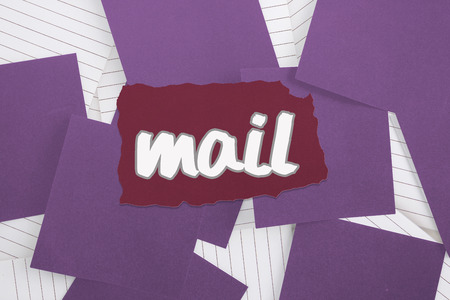 untidy text: The word mail against purple paper strewn over notepad Stock Photo
