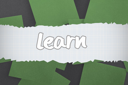 untidy text: The word learn against green paper strewn over black