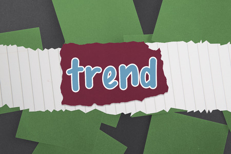 untidy text: The word trend against green paper strewn over black