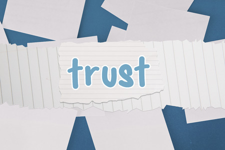 untidy text: The word trust against white paper strewn over blue
