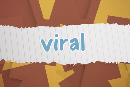 untidy text: The word viral against brown paper strewn over orange