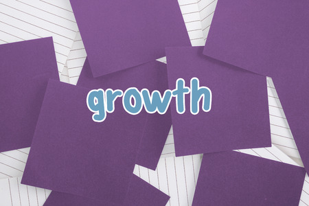untidy text: The word growth against purple paper strewn over notepad Stock Photo