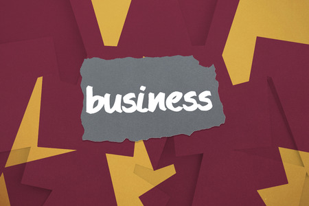 untidy text: The word business against wine paper strewn over orange Stock Photo