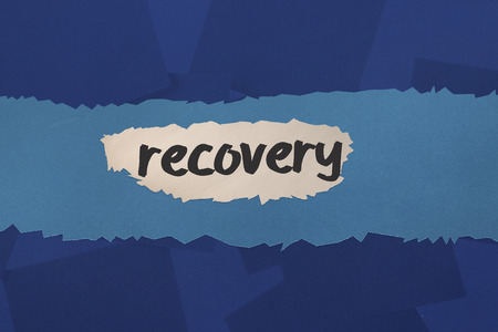 untidy text: The word recovery against digitally generated blue paper strewn