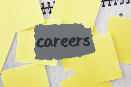 untidy text: The word careers against sticky notes strewn over notepad Stock Photo