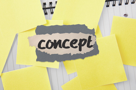 untidy text: The word concept against sticky notes strewn over notepad Stock Photo