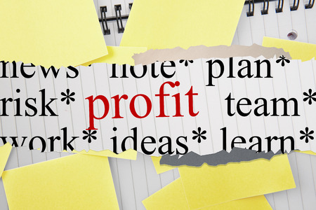 untidy text: The word profit against sticky notes strewn over notepad Stock Photo