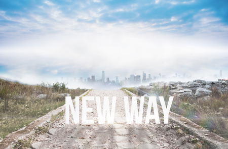 The word new way against stony path leading to misty cityscape