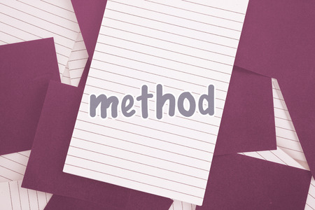 untidy text: The word method against purple paper strewn over notepad Stock Photo