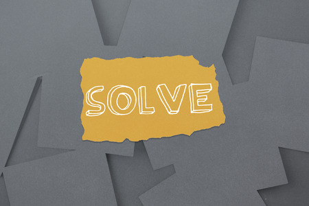untidy text: The word solve against digitally generated grey paper strewn