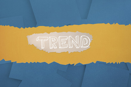 untidy text: The word trend against digitally generated blue paper strewn Stock Photo