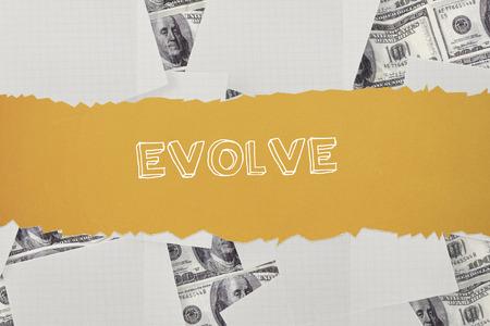 evoluer: Le mot �voluer contre papier blanc parsem� sur billets d'un dollar Banque d'images