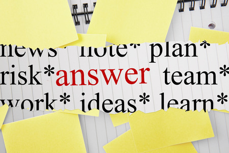 untidy text: The word answer against sticky notes strewn over notepad Stock Photo
