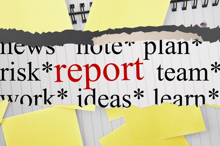 untidy text: The word report against sticky notes strewn over notepad Stock Photo