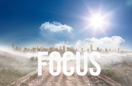 urban sprawl: The word focus against stony path leading to large urban sprawl under the sun Stock Photo