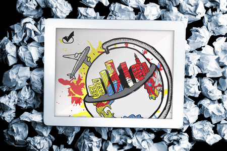 Global tourism concept on paint splashes on digital tablet on crumpled paper photo