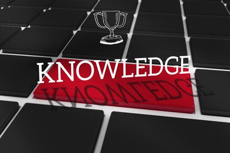 The word knowledge and winners cup against black keyboard with red key photo