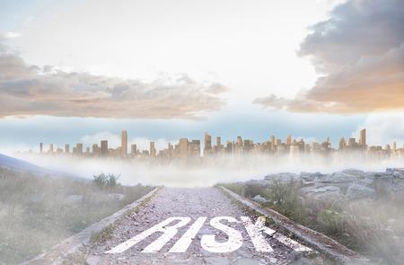 urban sprawl: The word risk against rocky path leading to large urban sprawl