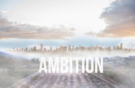 The word ambition against rocky path leading to large urban sprawl photo
