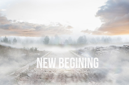 begining: The word new begining against stony path leading to misty forest