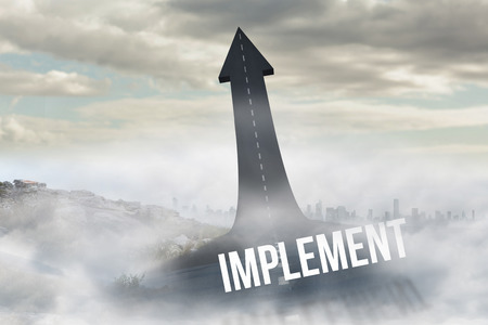 The word implement against road turning into arrow Stock Photo
