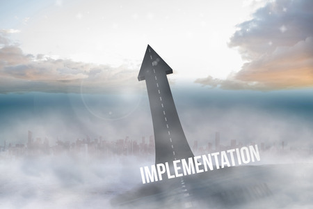 The word implementation against road turning into arrow