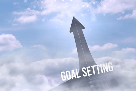 The word goal setting against road turning into arrow Stock Photo