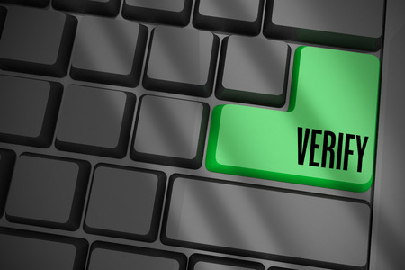 The word verify on black keyboard with green key