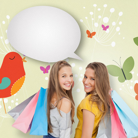 Two young women with shopping bags with speech bubble against orange bird with heart and dandelions photo