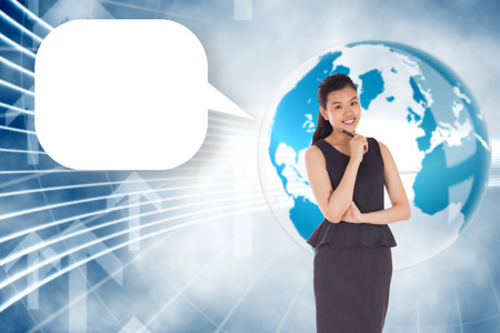Thoughtful asian businesswoman with speech bubble against global business graphic in blue photo