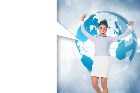 Excited brunette businesswoman with speech bubble against global business graphic in blue photo