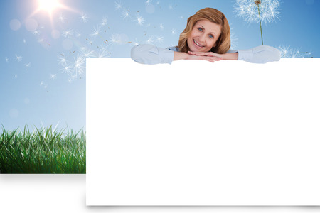 Composite image of businesswoman showing white card photo