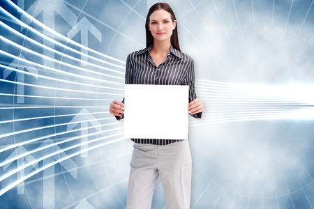 Businesswoman showing card against arrow graphics in blue and white photo